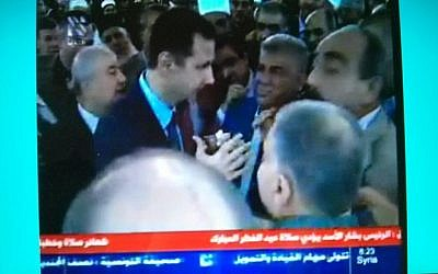 Syrian President Bashar Assad appears on state television shortly after reports of an attack on his presidential convoy Thursday August 8, 2013. (Photo credit: Fernande van Tets/Twitter)