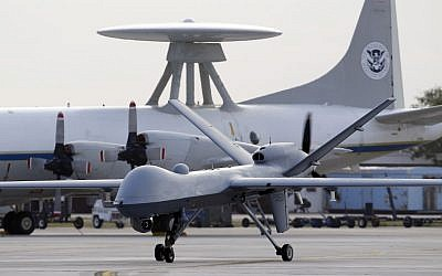 A Predator B unmanned aircraft taxis at the Naval Air Station in Corpus Christi, Texas. (photo credit: AP/Eric Gay)