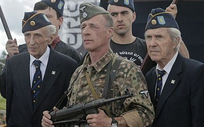 SS Galician Division veterans, left and right foreground, near the village of Yaseniv in western Ukraine on Sunday, July 21, 2013. (photo credit:AP/Efrem Lukatsky)