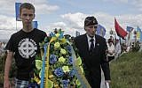 Yevhen Kutsik, 86, former soldier of SS Galician Division, right, and a young Ukrainian nationalist lay a wreath on a monument to SS Galician Division, Sunday, July 21, 2013. (photo credit:AP/Efrem Lukatsky)