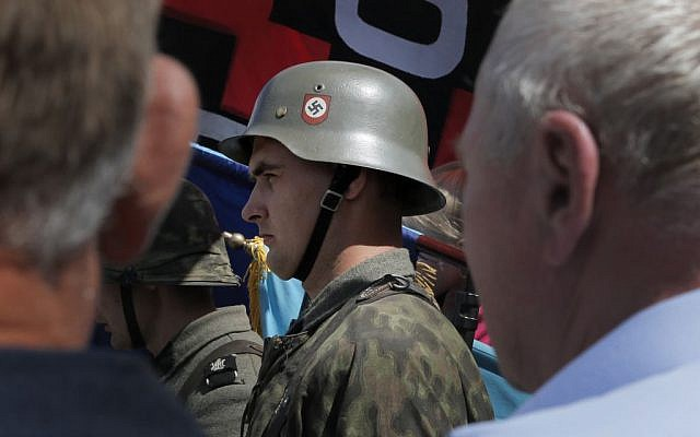Ukrainian dressed in the SS Galician Division uniform, Sunday, July 21, 2013. (photo credit: AP/Efrem Lukatsky)