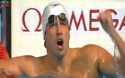 Guy Barnea celebrates in the pool after winning his semifinals heat in the 50 meter backstroke at the World Championships in Barcelona, Saturday, August 4, 2013 (photo credit: Channel 1 screen capture)