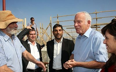 Then housing minister Uri Ariel (second from right) and then deputy transportation minister Tzipi Hotovely (right) during visit to the settlement of Kochav Yaakov in August 2013 (photo credit: Sasson Tiram/ Ministry of Housing and Construction)