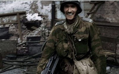Frame grab made available by the Warsaw Rising Museum shows Witold Kiesun taken from snippets of historical footage from the 1944 Warsaw Uprising, enhanced by modern coloring and sound techniques (AP/Warsaw Rising Museum)