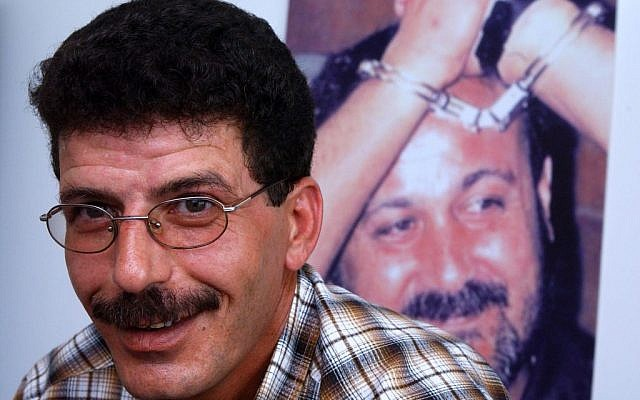Qadura Fares, with a picture of jailed Fatah Tanzim leader Marwan Barghouti in the background (photo credit: Flash90)