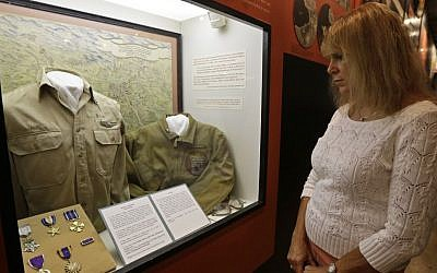 Karen Warner views a display on the Ploesti Raid in World War II that shows a shirt worn by her father, Lt. Col. Jack Warner, while touring the United States Air Force Museum, Wednesday, July 31, 2013, in Dayton, Ohio. (photo credit: AP Photo/Al Behrman)