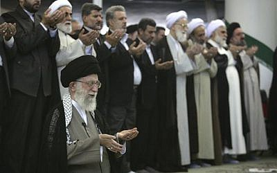 Iranian Supreme Leader Ayatollah Ali Khamenei, front row left, leads the Eid al-Fitr prayer, marking the start in Iran of the Eid al-Fitr holiday Aug. 9, 2013 (AP Photo/Office of the Iranian Supreme Leader)