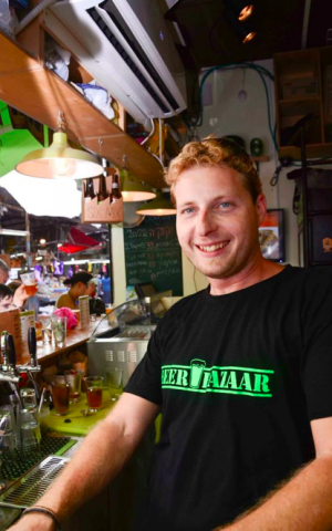 Yuval happily pours beer all day, every day (Courtesy Beer Bazaar)