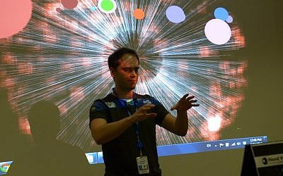 A member of the team demonstrating Hand Your Music, the app that won the Intel Israel Perceptual Computing Hackathon. (photo credit: Courtesy)