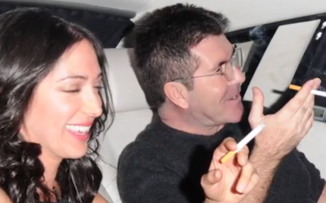 Simon Cowell and Lauren Silverman (photo credit: screenshot/YouTube/File)