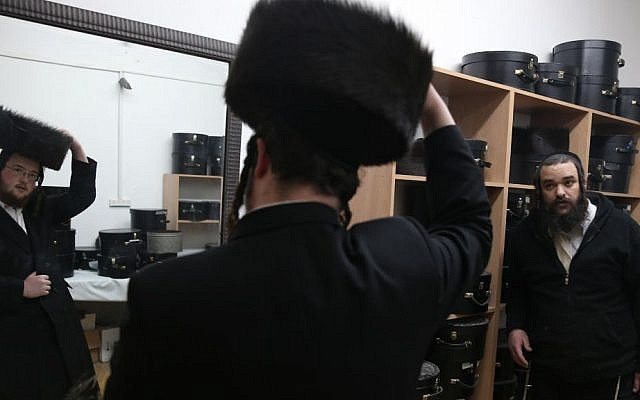 Illustrative photo of a man trying on a shtreimel in the ultra-Orthodox neighborhood of Mea Shearim, Jerusalem. (photo credit: Nati Shohat/Flash90)