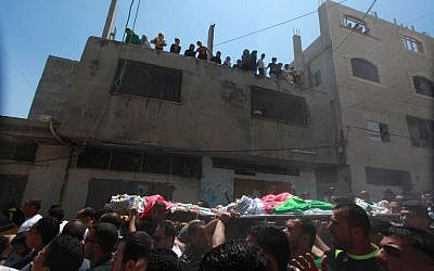 Hundreds attend the funeral of three Palestinian men shot dead by Israeli troops in the Qalandiya refugee camp in the West Bank, Monday, August 26, 2013 (photo credit: Issam Rimawi/Flash90)