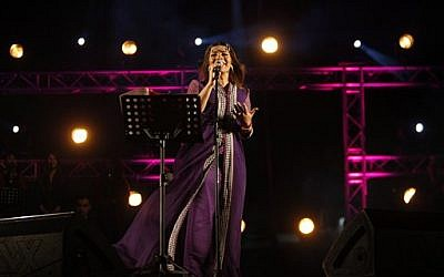 Syrian singer Asala Nasri performs at a concert in the West Bank city of Bethlehem, August 10, 2013. (photo credit: AP/Majdi Mohammed)