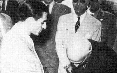 Prime minister Mohammad Mossadegh shaking hands with Mohammad Reza Schah Pahlavi in 1951. (Wikipedia)