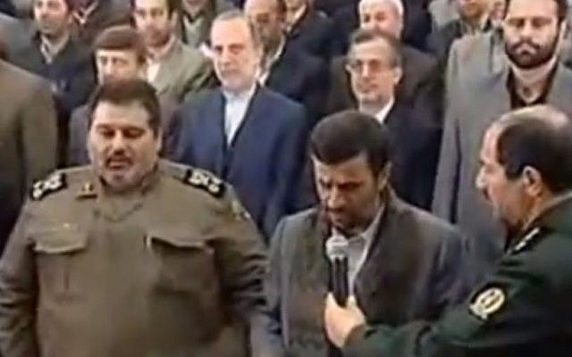 Hassan Firouzabadi, left, with Mahmoud Ahmadinejad in 2011. (Screenshot: Youtube)
