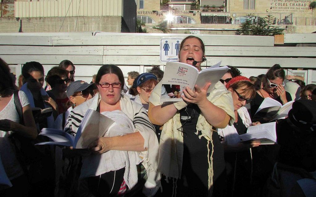 Two members of Women of the Wall lead the Rosh Hodesh prayer service (Debra Kamin/Times of Israel)