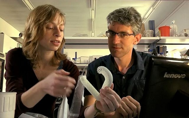 Esther Goldblum, an engineering student at the center for bioengineering, Hebrew University of Jerusalem, and Dr. Yaakov Nahmias, director of the center, examine the MetaboShield. (photo credit: Courtesy)