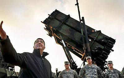 Former US Deputy Defense Secretary Ashton B. Carter with troops next to a Patriot anti-missile battery on the Turkish-Syrian border in February, 2013. (photo credit:  Glenn Fawcett/ US Department of Defense)