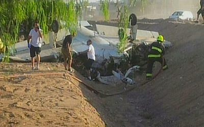 Emergency personnel surround a plane that crashed in the southern city of Eilat, Thursday, August 1, 2013 (photo credit: Channel 2)