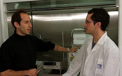 Dr. Ernesto Joselevich (left) and a student near carbon nanotube synthesis reactor (photo credit: Weizmann Institute)