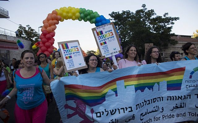 Israelis take part in the annual Gay Pride parade in Jerusalem on August 1, 2013. (photo credit: Sarah Schuman/Flash90)