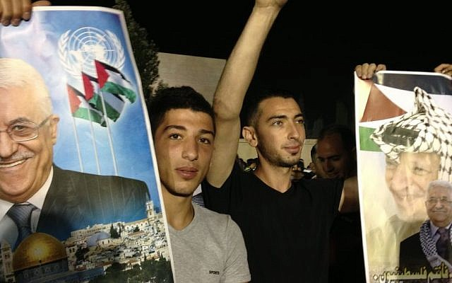 Young Palestinians celebrate the release of 11 prisoners to the West Bank early Wednesday, August 14. (photo credit: Elhanan Miller/Times of Israel)