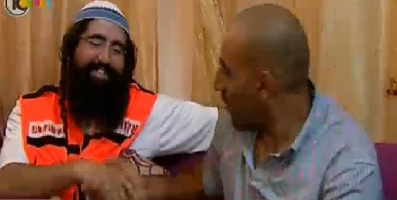 Attias and Azloni together in Azloni's home in the Muslim Quarter of Jerusalem's Old City (photo credit: Channel 10 News screen cap)