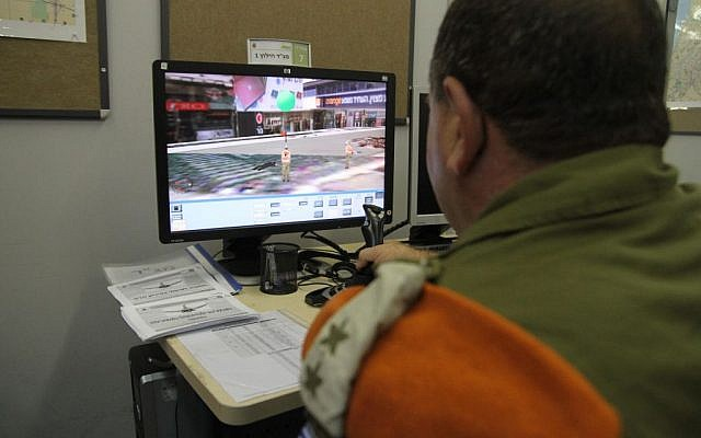 A battalion commander in the IDF Home Front Command uses a simulator during a recent drill (photo credit: Courtesy: IDF Spokesperson's Office)