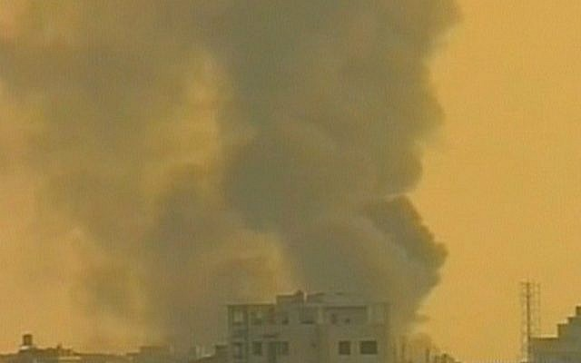 Smoke billows over a Hezbullah stronghold in Lebanon in the wake of a car bombing attack, Thursday, August 15, 2013 (photo credit: Channel 2 screen capture)