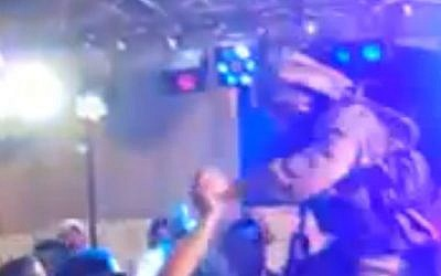 An IDF soldier dancing at a party in Hebron earlier this week. (Screenshot: YouTube)