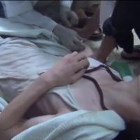 A man suffering a seizure, from a video reporting to show victims of the chemical attack outside Damascus on August 21, 2013. (Screenshot: YouTube)