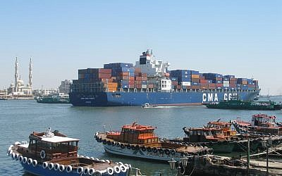 A container ship passing through the Suez Canal. (photo credit: CC BY Argenberg, Flickr)