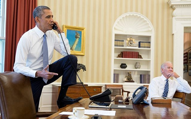 Barack Obama speaking to House Speaker John Boehner from the Oval Office Saturday as Joe Biden looks on. (photo credit: Pete Souza/ Official White House)