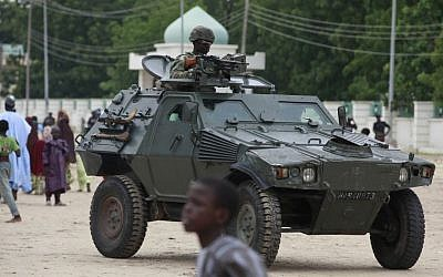 Illutrative photo of Nigerian soldiers in an armored vehicle following a terrorist attack, August 2013 (photo credit: AP/Sunday Alamba/File)