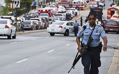 In a 2013 attack, a police officer walks near the Washington Navy Yard after at least one gunman launched a deadly attack inside the heavily secured military installation (photo credit: AP/Jacquelyn Martin)