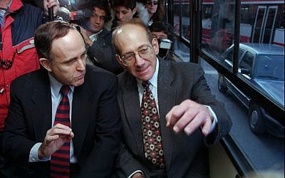 New York mayor Rudy Giuliani, left, gestures as he rides Jerusalem's bus No.18 with Jerusalem's mayor Ehud Olmert, on a visit in 1996 (AP/Brian Hendler)