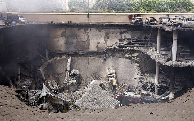 This photo released by the Kenya Presidency shows the collapsed upper car park of the Westgate Mall in Nairobi, Kenya Thursday, September 26, 2013. Working near bodies crushed by rubble in a bullet-scarred, scorched mall, FBI agents continued fingerprint, DNA and ballistic analysis to help determine the identities and nationalities of victims and al-Shabab gunmen who attacked the shopping center, killing more than 60 people. (photo credit: AP Photo/Kenya Presidency)