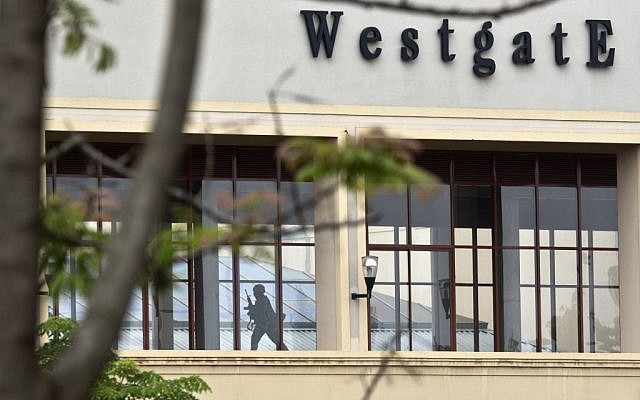 A Kenyan soldier runs through a corridor on an upper floor, shortly before an explosion was heard, at the Westgate Mall in Nairobi, Kenya Tuesday, Sept. 24, 2013.  (photo credit: AP/Ben Curtis)