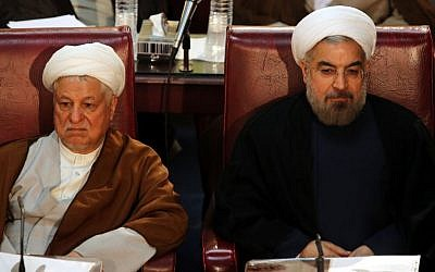 Hassan Rouhani (right) and Akbar Hashemi Rafsanjani during a session of Assembly of Experts in Tehran, September 2013. (AP)