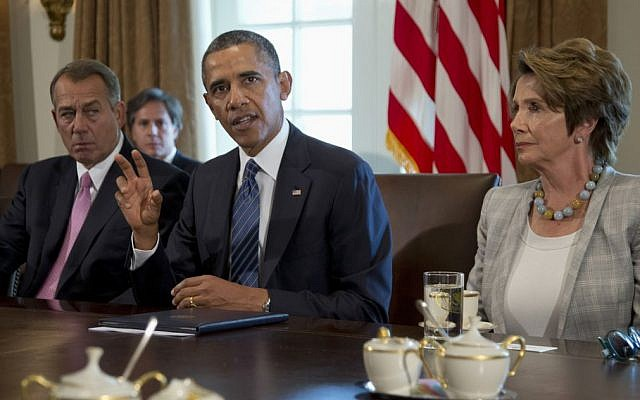 President Barack Obama, flanked by House Speaker John Boehner of Ohio, left, and House Minority Leader Nancy Pelosi of California, speaks to media in the Cabinet Room of the White House in Washington, Tuesday, September 3, 2013 (photo credit: AP/Carolyn Kaster)