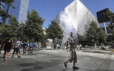 A visitor to the National September 11 Memorial and Museum takes in the sight as he walks past the museum, Friday, Sept. 6, 2013 in New York. (photo credit: AP Photo/Mary Altaffer)
