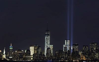 The Tribute in Light rises above the lower Manhattan skyline and One World Trade Center, center, in a test of the memorial light display, Monday, September 9, 2013 in New York (photo credit: AP/Mark Lennihan)