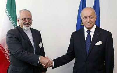 Iranian Foreign Minister Mohammad Javad Zarif, left, and French Foreign Minister Laurent Fabius shake hands before conducting a bilateral meeting during the 68th session of the United Nations General Assembly at UN headquarters, Wednesday, September 25, 2013. (photo credit: AP/Jason DeCrow)