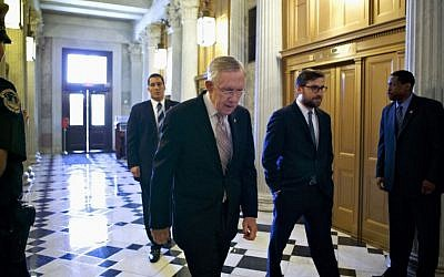 US Senate Majority Leader Harry Reid of Nevada makes his way to the Senate floor on Capitol Hill in Washington on Friday, Sept. 6, 2013, to introduce a resolution to authorize military action to support President Barack Obama's request for a strike against Syria. (photo credit: AP Photo/J. Scott Applewhite)
