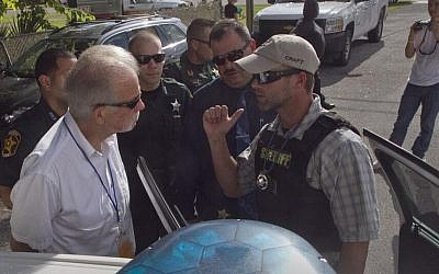 Pastor Terry Jones is arrested on his way to burn 2,998 Qurans to mark the anniversary of the 9/11 attacks on Wednesday, in Mulberry, Florida (photo credit: @theledger via Twitter)