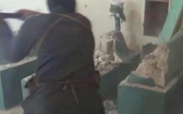 This image uploaded to Twitter on Wednesday is purportedly of al-Qaeda-linked terrorists demolishing ancient Jewish mausoleums in Aleppo, Syria (photo credit: @Yasmeena_Hedaya via Twitter)
