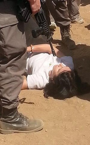 A photo, taken by an aid worker, purports to depict French diplomat Marion Fesneau-Castaing being forced to the ground by IDF soldiers Friday. The photo was widely circulated around Twitter. (photo credit: Courtesy/anonymous via Hugh Naylor/Twitter)