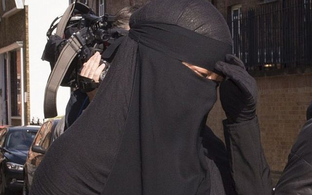 A Muslim woman, who cannot be named for legal reasons, arrives at a London court, where a judge has ruled that she will be allowed to stand trial while wearing a full-face veil, but that she must remove it when giving evidence. (photo credit: AP/Stefan Rousseau)