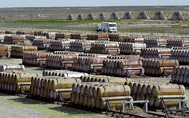 This 2001 file photo shows a safety vehicle passing a compound filled with 170-gallon containers of mustard and blister agent at the Deseret Chemical Depot in Tooele, Utah. (photo credit: AP/Douglas C. Pizac/File)