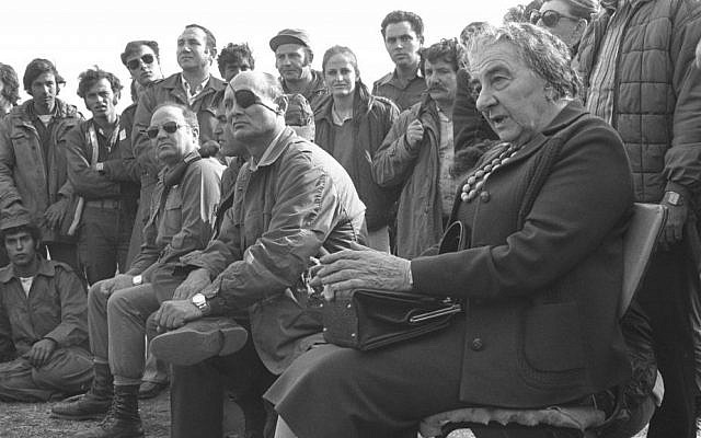 Prime minister Golda Meir and defense minister Moshe Dayan meeting with troops on the Golan Heights, on November 21, 1973. (Ron Frenkel/GPO)